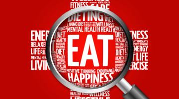 EAT word cloud with magnifying glass, health concept